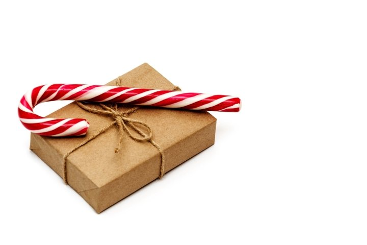 Christmas gift box wrapped in kraft paper and candy cane