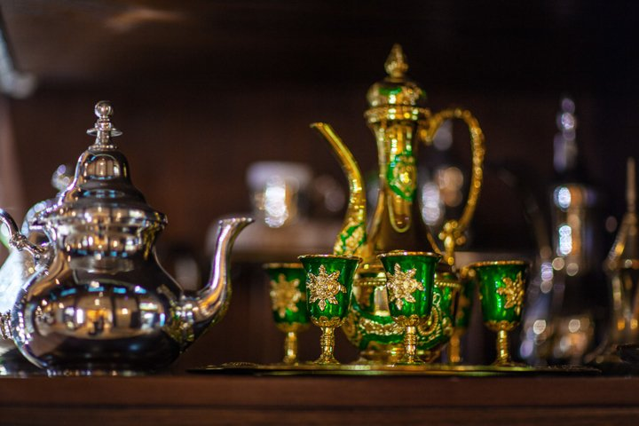 Arabian cup and teapot of gold on the eastern market