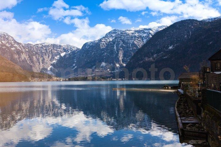 View idyllic Alpine mountains and lake. Sunny winter morning