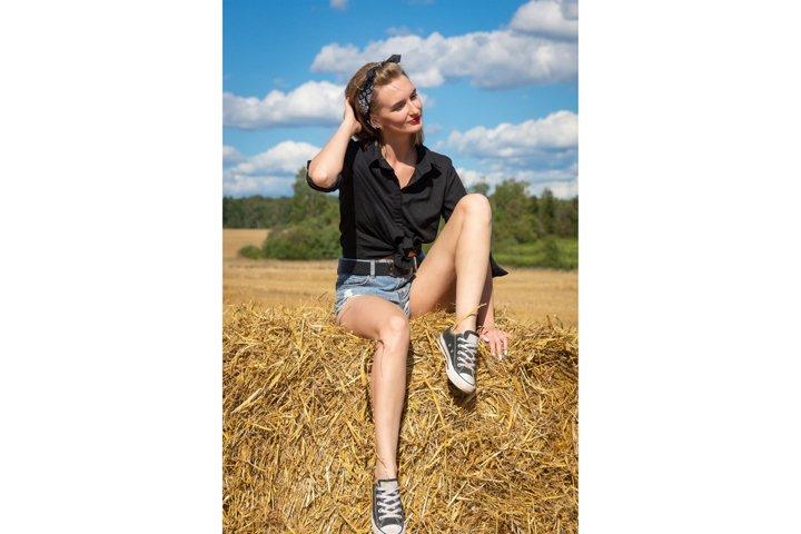 girl on a sheaf of hay