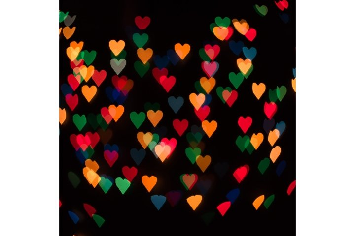 Defocused abstract multicolored heart shape bokeh lights