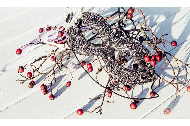 Old white wood and red berries. Christmas background