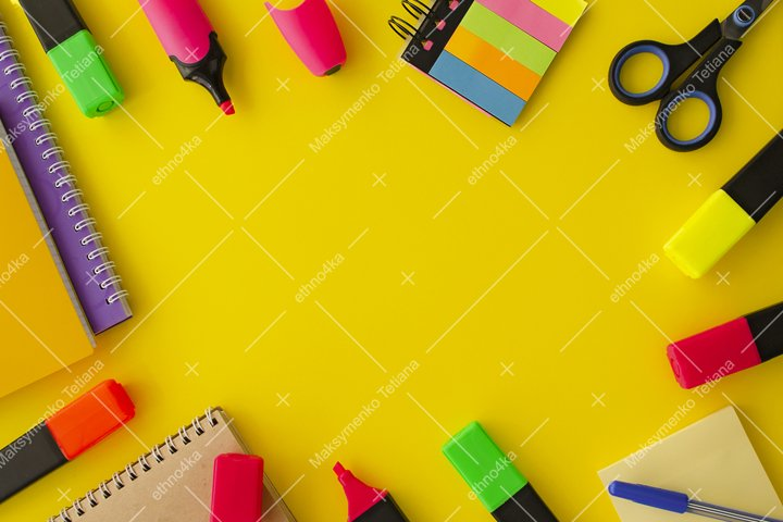 Decorative frame of stationery on yellow background flat lay