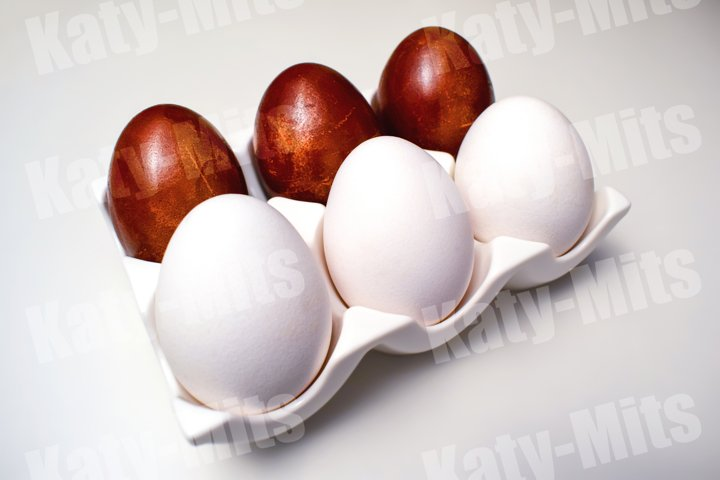 White and colored eggs in a ceramic stand