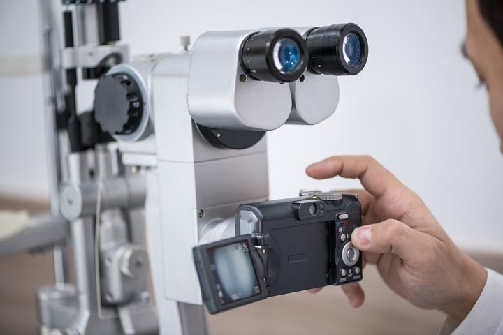 Ophthalmologist at work. Diagnostic ophthalmic equipment