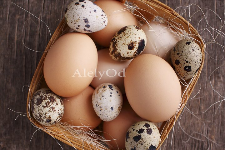 Quail and chicken eggs in a basket