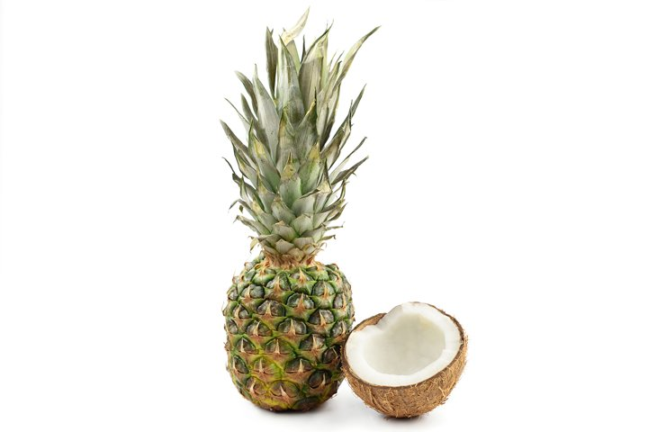 food ripe tropical fruit pineapple whole and a half coconut