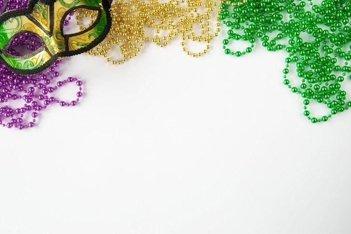 Mardi gras background, purple, green, and gold beads, mask