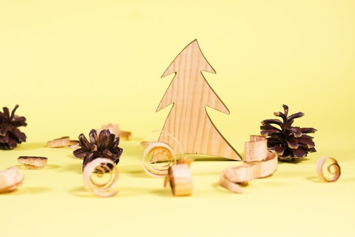 Wooden fur-tree and curled shavings on yellow