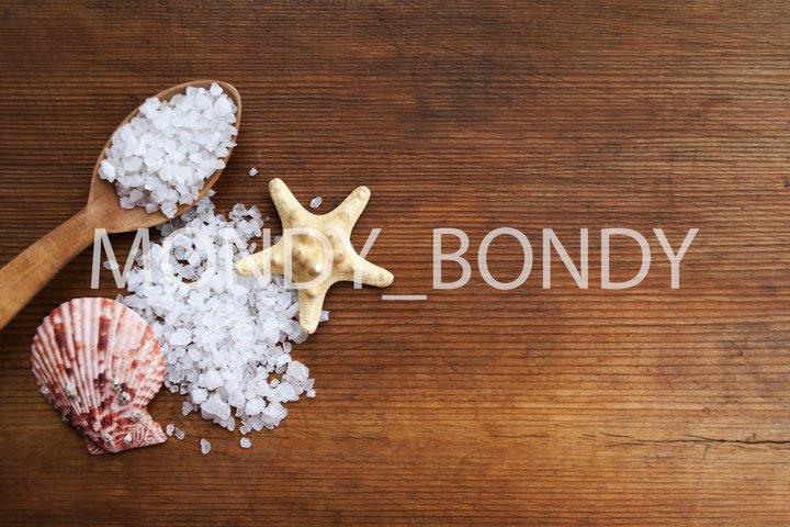 Sea white salt, starfish, shell on wooden background