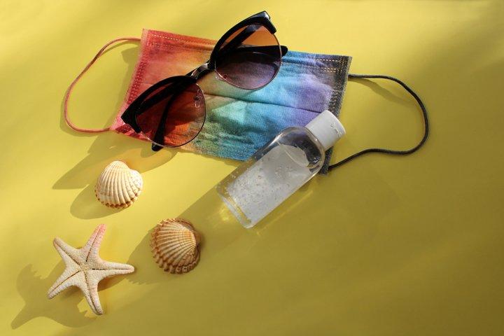 Summer vacation flat lay. Travel and pandemic of coronavirus