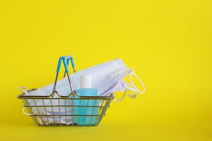 Medical face masks and bottle of hand sanitizer gel.
