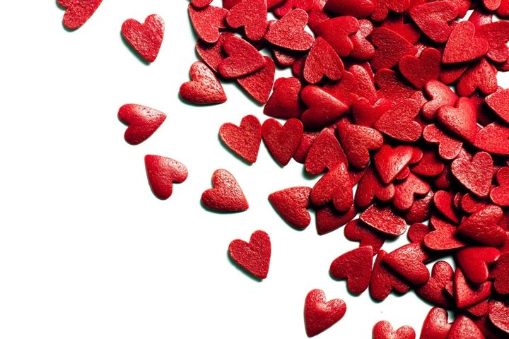Valentines day background with red candy hearts isolated