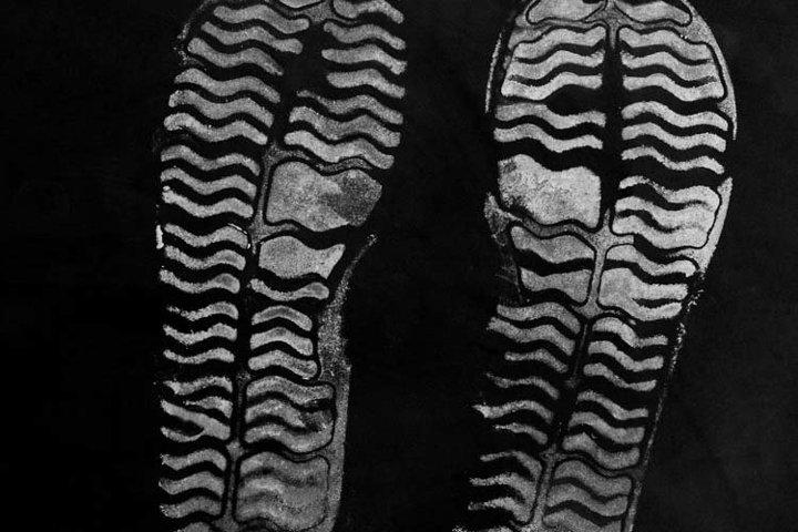 highly detailed white sandal print on black background