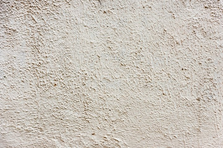 Light plaster walls, unfinished texture or background.