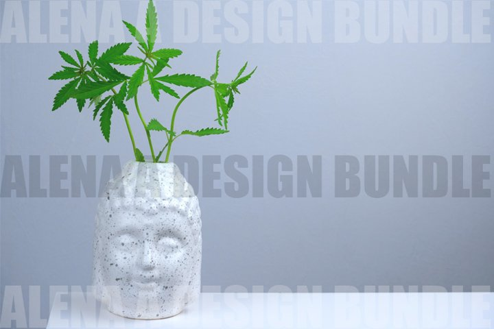 White Buddhas head with green marijuana leaves