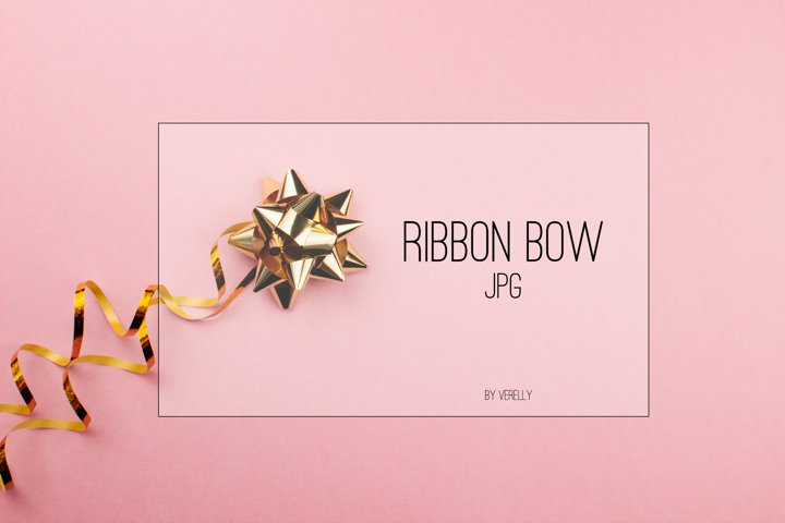 Golden ribbon bow on pink background