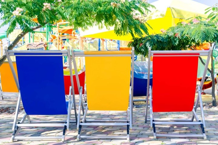 Pool loungers in 3 bright colors - blue, yellow, red