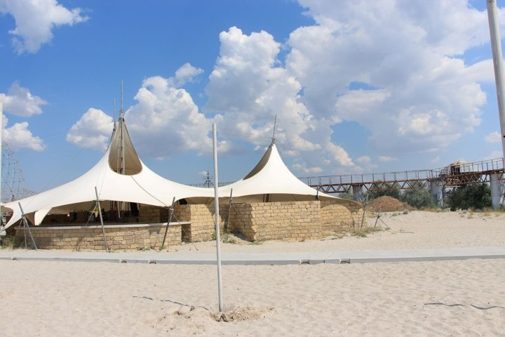 white tents-cafes on the beach