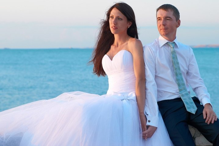 Beautiful wedding couple- bride and groom at the beach