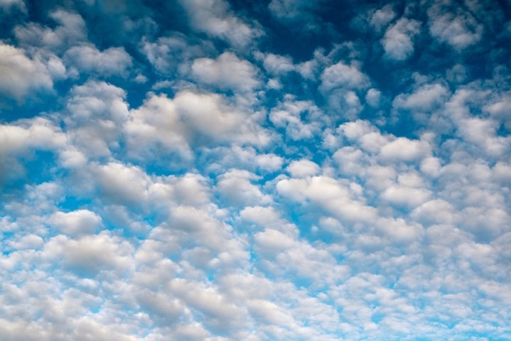 Blue sky background with white clouds. Beautiful cloudscape