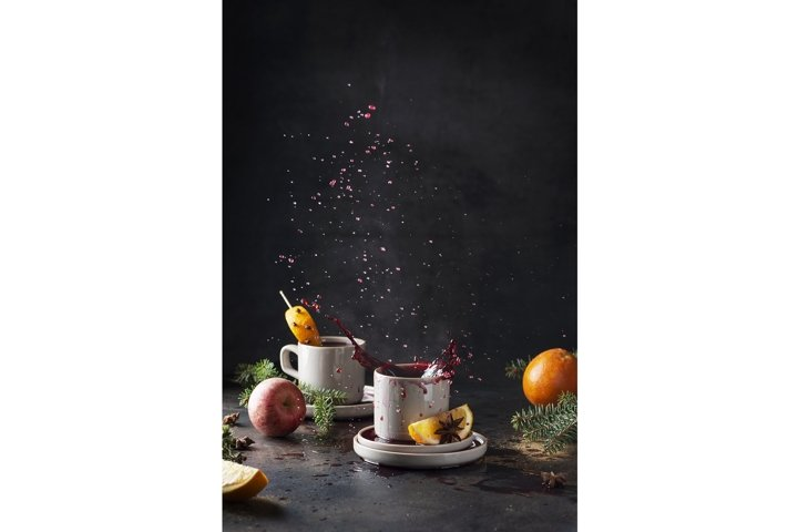 Winter concept. Hot mulled wine with steam puoring