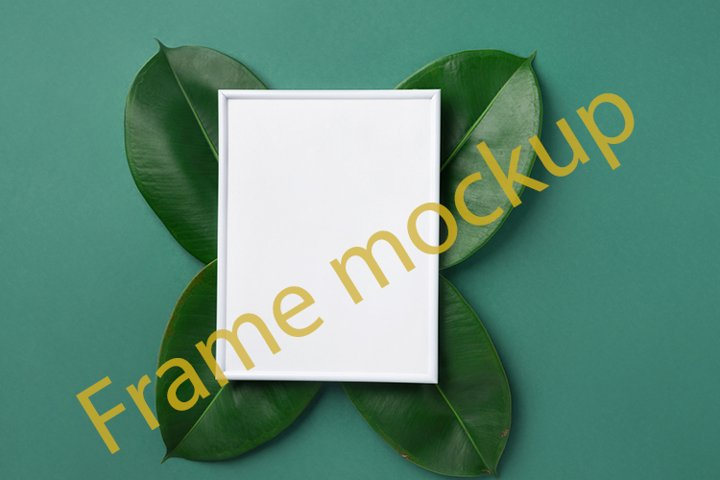 White frame mockup tropical plant leaves on green