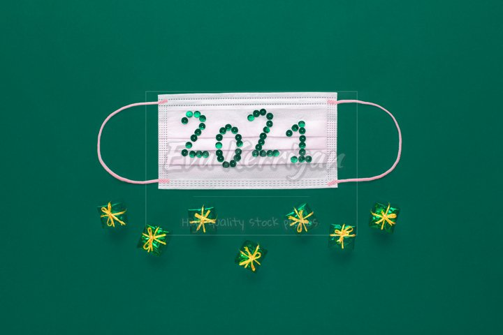 Postcard for New Year or Christmas. Mask with 2021.