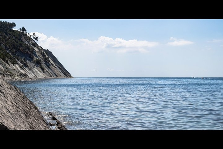 Panorama of the seascape. A picturesque stone beach. 2pcs