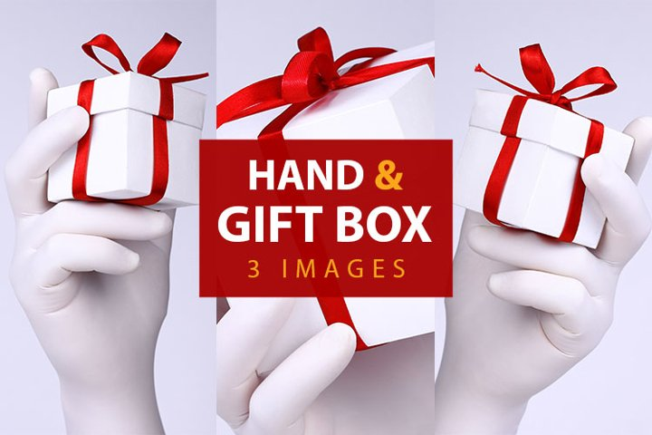 Hands in white glove with gift box on light background.