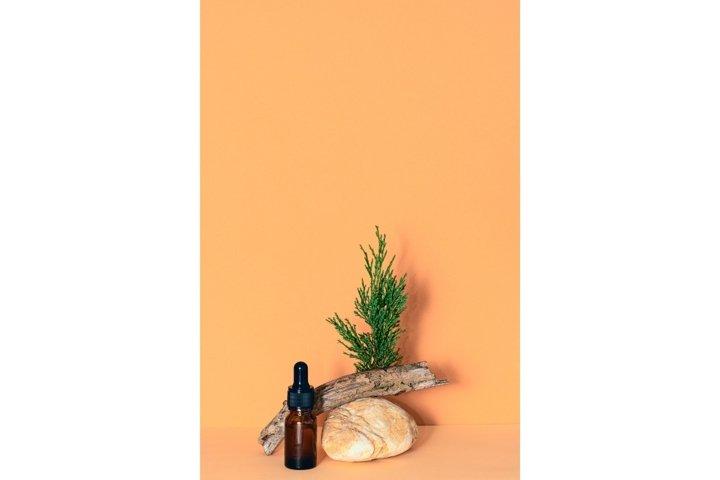 Dropper glass bottle of essential oil. Biophilic design