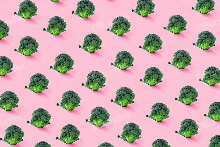 Seamless minimalistic pattern with broccoli on a pink