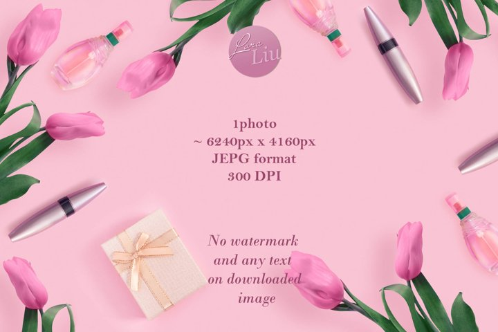 Beautiful pink tulips with gold gift box and cosmetics