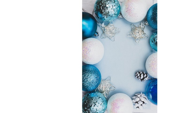 Frame made of Christmas blue, white balls, garland and cones