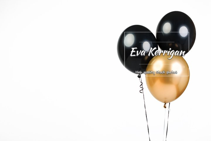 Three balloons, black and gold, isolate.