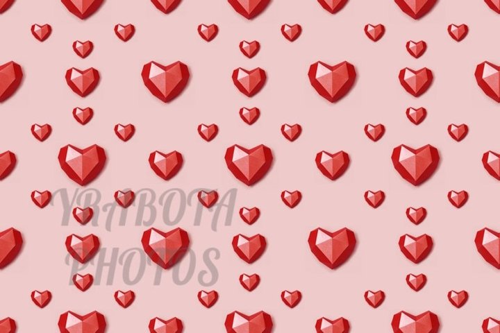 Seamless pattern from red polygonal paper hearts