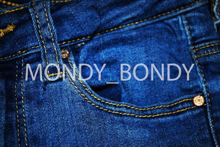 Close-up pocket on denim blue pants