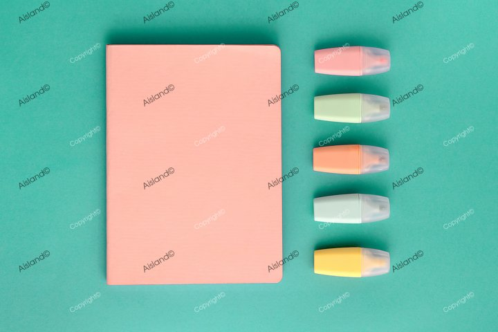 Pastel school supplies, notebook and markers on mint