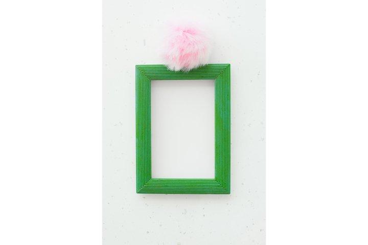Wooden green photo frame on white background