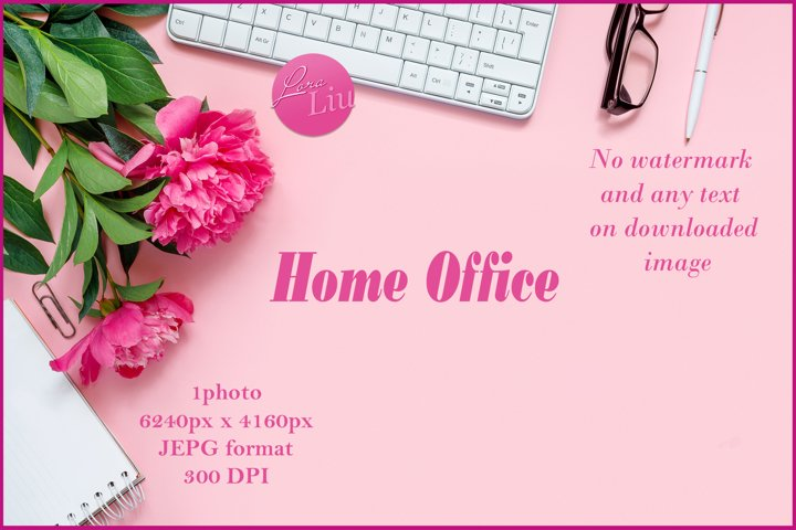 Laptop with glasses headphones and bouquet of peonies