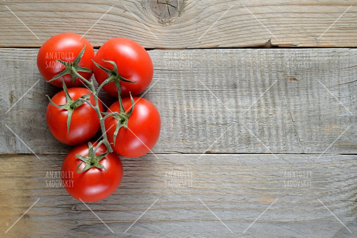 Tomatoes on wooden table top view