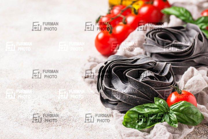 Black uncooked pasta tagliatelle