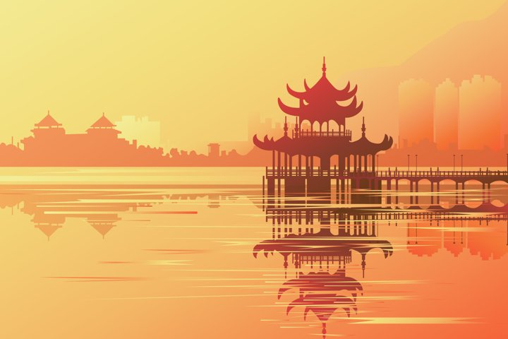 Sunrise over a Buddhist temple reflected in the water.