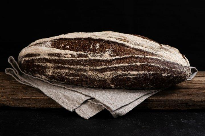 Freshly baked homemade artisan sourdough rye bread. Closeup