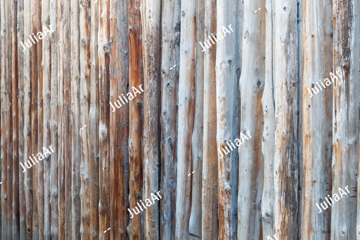 Tree trunk fence. Background.