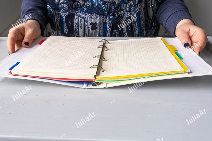Girl at desk with open binder notebook