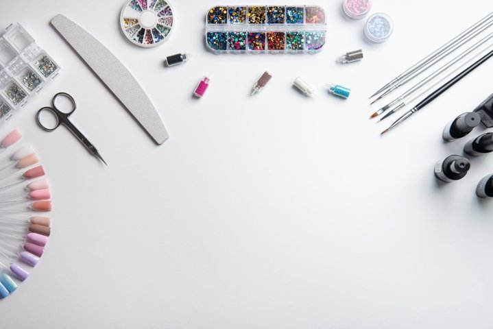 Top view of manicure equipment on white background