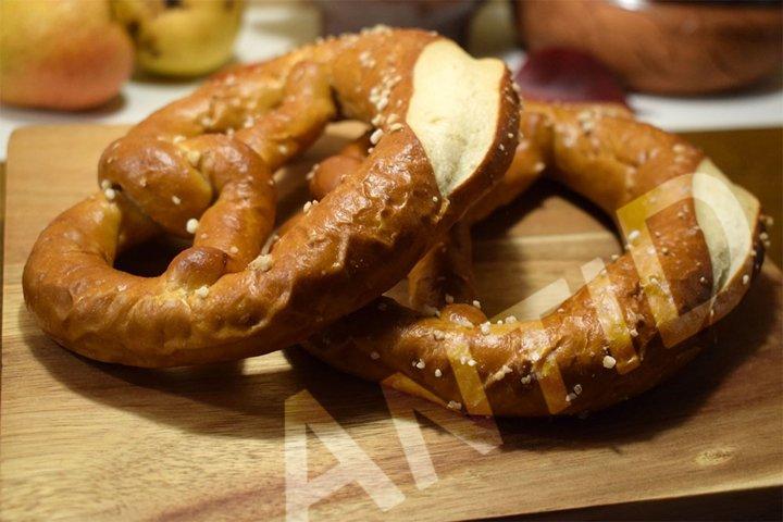 Homemade fresh pretzel on wooden kitchen