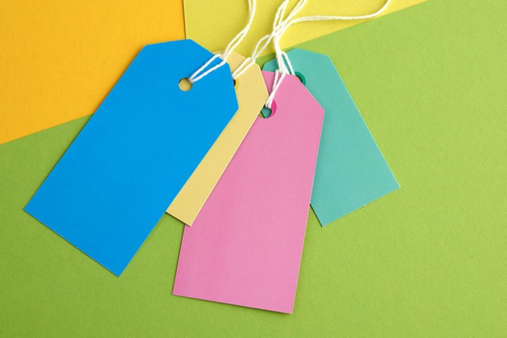 paper rectangular tags on a rope on a colored background