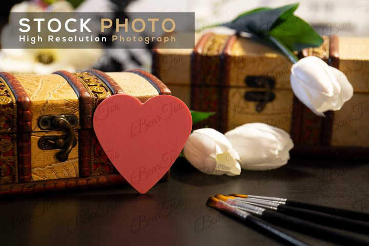 Heart Shaped Post-It Stock Photo on Wood with Chests Flowers